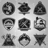 Premium Blacksmith Emblems Set. In black colors with master weapons and equipment on vintage background isolated vector illustration Royalty Free Stock Images