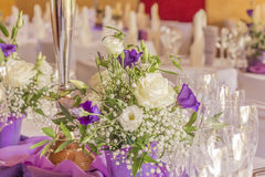Premium dinner gala table with napkins glasses and flowers. High class arrangement for e.g. a wedding, birthday or business meeting Royalty Free Stock Photos