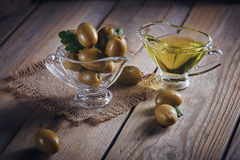 Premium extra virgin olive oil and green olives with fresh herbs Royalty Free Stock Image