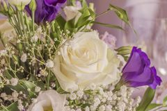 Premium flowers with wonderful white and purple roses. High class arrangement for e.g. a wedding, birthday or business meeting Stock Photography