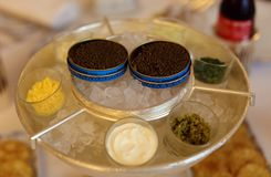 Premium french black beluga caviar in can VIP luxury food, appetizer ready to eat in Europe. High class gastronomy at 5 stars hotel in France Royalty Free Stock Photos