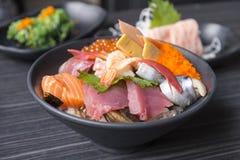 Premium fresh raw seafood mixed rice bowl & x28;Kaisen-don/ Japanese. Tasty food& x29;, Japanese Rice with sashimi of tuna, Maguro, Otoro, salmon, squid and Stock Images