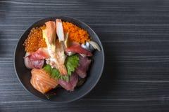 Premium fresh raw seafood mixed rice bowl & x28;Kaisen-don/ Japanese. Tasty food& x29;, Japanese Rice with sashimi of tuna, Maguro, Otoro, salmon, squid and Stock Photos
