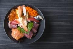 Premium fresh raw seafood mixed rice bowl & x28;Kaisen-don/ Japanese. Tasty food& x29;, Japanese Rice with sashimi of tuna, Maguro, Otoro, salmon, squid and Stock Photo