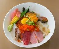 Premium fresh raw-seafood on rice (Kaisen Don). Royalty Free Stock Images