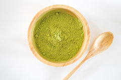 Premium green tea powder in wooden bowl Royalty Free Stock Images