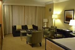 Premium Hotel Room. Interior of hotel room in warm tone. Queen size bed and relax zone Stock Image