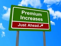 Premium Increases ahead sign. Premium Increases just ahead sign with blue sky and cloudscape background Stock Images