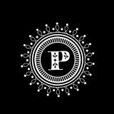 Premium monogram with English Alphabet P. Stylish premium monogram design with English Alphabet P in a floral decorated rounded frame on black background Stock Image