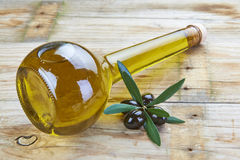 Premium olive oil and black olives Stock Image
