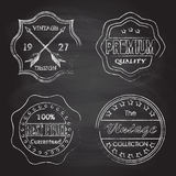 Premium quality, best price, vintage design badges and labels set  on blackboard texture with chalk rubbed background. Royalty Free Stock Photos