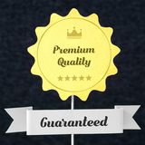 Premium quality guaranteed badge cut from cardboard Stock Images