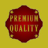 Premium quality label. Premium quality badge on a yellow background with stars Stock Photography