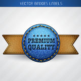Premium quality label. Vector leather and jeans premium quality label design Stock Photos