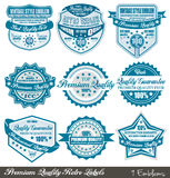 Premium Quality and Satisfaction Guarantee labels. With retro graphic style and delicate colours Royalty Free Stock Images