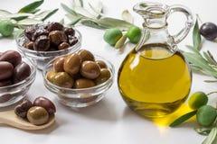 Premium virgin olive oli and variety of olives. Stock Photo
