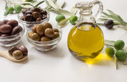 Premium virgin olive oli and variety of olives. Royalty Free Stock Images