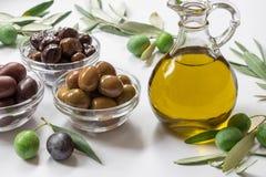 Premium virgin olive oli and variety of olives. Stock Image