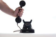 Prenant le téléphone - il est pour vous Images libres de droits