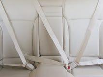 Prenda cintos de segurança no carro para a segurança Imagem de Stock Royalty Free