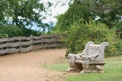 Prenda un sedile fra i leoni Immagine Stock