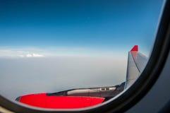 Prenda una foto del cielo dall'aeroplano Fotografie Stock Libere da Diritti