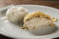 Prendedero de abadejos con arroz del coco Foto de archivo libre de regalías