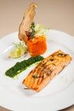 Prendedero de color salmón con puré de la zanahoria Foto de archivo libre de regalías