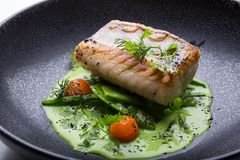 Prendedero de pescados blancos cocinado Imagen de archivo libre de regalías