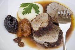 Prendedero del cerdo con puré de la salsa y de patata Imagen de archivo libre de regalías