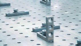 Prendedores na superfície de funcionamento da unidade industrial Placa met?lica com furos filme