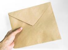 Prendendo um envelope Foto de Stock