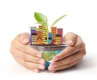 Prendendo um globo de incandescência da terra em suas mãos Imagem de Stock Royalty Free