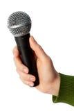 Prendendo um microfone Imagem de Stock Royalty Free
