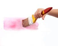 Prendendo uma escova para pintar Fotografia de Stock Royalty Free