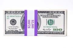 Prendido com correias cem contas de dólar Imagens de Stock Royalty Free