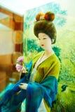 Prenez à la femme de fleur les figurines en soie xian Photos libres de droits