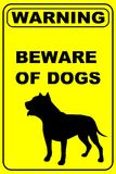 Prenez garde du panneau d'avertissement de chiens photographie stock libre de droits