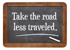 Prenez la route moins a voyagé Photo stock