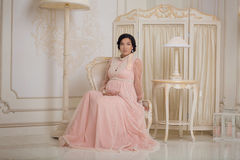 Prengant Lady In Vintage Interior Royalty Free Stock Photography