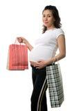 Prengnant Fraueneinkaufen stockbilder