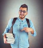 Prenota il nerd del ragazzo immagini stock libere da diritti