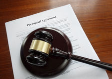 Prenup and gavel. Prenup agreement on a desk with legal gavel Stock Images