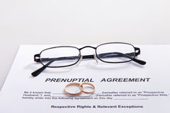 Prenuptial Agreement form and two wedding rings Stock Photo