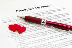Prenuptial agreement with hearts stock photo