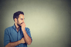 Preoccupied anxious young man. Worried thinking Stock Image