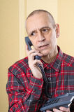 Preoccupied Man on Phone Stock Images