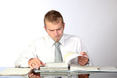 Preoccupied Reviewing Documents. Young Corporate Man Being Preoccupied While Reviewing Some Documents Royalty Free Stock Images