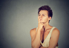 Preoccupied thinking man looking up. Preoccupied thinking young man looking up Stock Images