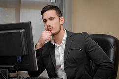 Preoccupied, worried young male office worker Stock Photo